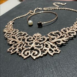 Rose gold necklace and matching bracelet.